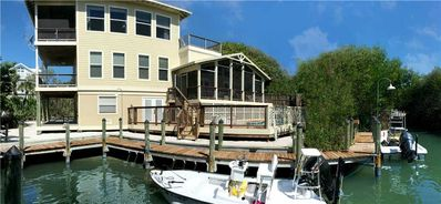 Photo for SOLITUDE: 4 BEDROOM HOME WITH WATERFRONT VIEWS , PRIVATE BOAT DOCK, POOL , AND BEACH ACCESS