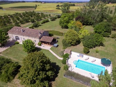 Photo for Private gated fenced secure pool, hot tub, covered outside dining area, short drive to restaurant