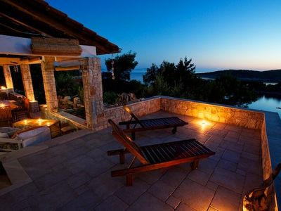 Photo for Steps to the sea   stunning views   lovely sunsets from the verandah