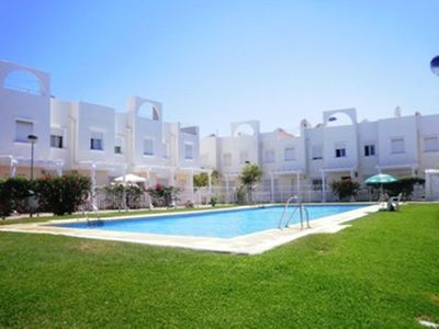 Photo for Townhouse with Solarium and Community Pools in Vera Playa, Almeria