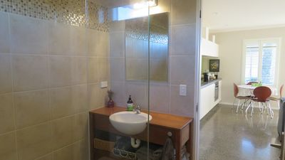 Modern bathroom with heated towel rail supplying warm dry towels