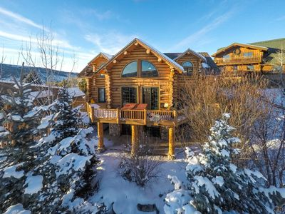 3 level custom log home with wraparound deck and patio.