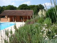 Lovely spacious holiday home with excellent large garden, outside kitchen and swimming pool.