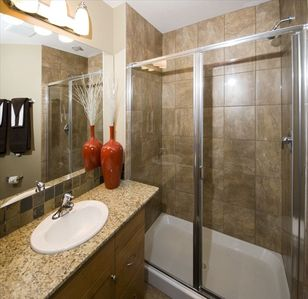 Bathroom with granite countertop and shower/bath