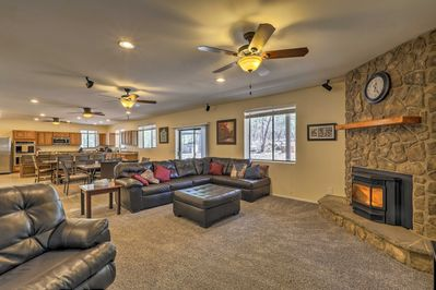 The spacious interior boasts 5 bedrooms, 3 bathrooms, and sleeping for 16.