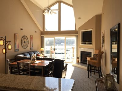 Living room with vaulted windows to maximize your view.