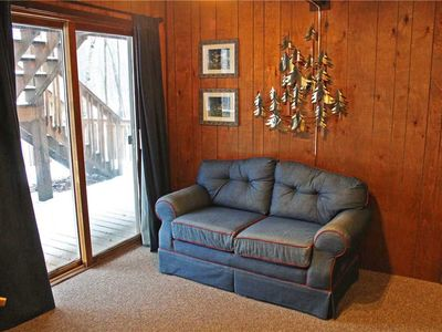 Photo for A Charming Vacation Home in a Wooded Setting With Cozy Decor And Allows Dogs