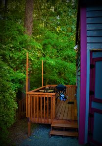 Private deck with relaxing seating area overlooking the trees