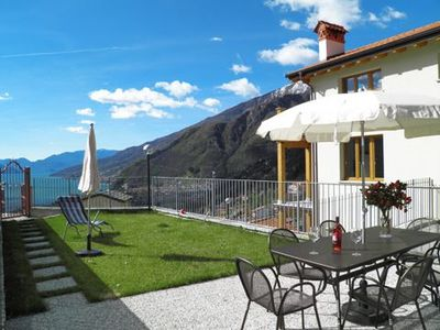 Photo for Holiday apartment Casa Sandra has a large garden terrace with wonderful view of the lake