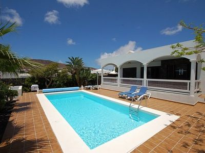 Photo for Stunning family Villa with private heated pool in a quiet residential area.