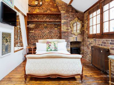 Photo for Quirky 1BR Mews with exposed brick walls, short walk to Liverpool St, by Veeve