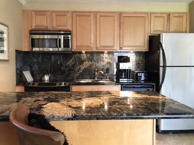 Kitchen - stainless steel appliances and granite countertops