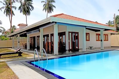 Front Of Villa With Large Pool