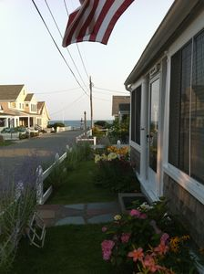 Photo for Beautiful Cape Cod Cottage Steps from Nantucket Sound and Sandy Private Beach