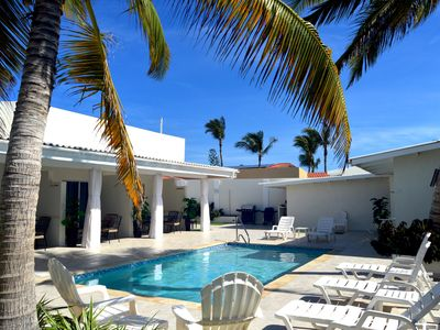 Photo for Deluxe Palm Beach Suite Steps Away from the Beach