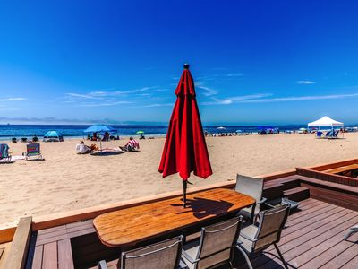 Photo for Relax and soak in the sun on your beach front patio. CS 110