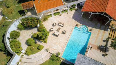 Photo for Standing villa, feet in the water, panoramic sea view, pool