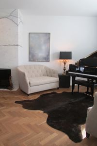 Living room with baby grand piano