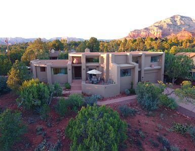 Custom home sits high on a .5 acre lot amidst evergreen trees & sounds of nature