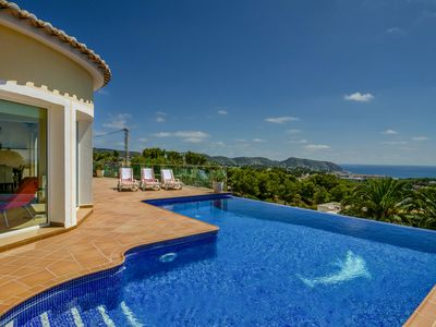 Photo for Unique villa overlooking the sea with infinity pool and views over Moraira