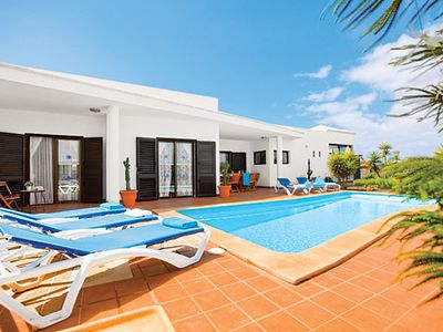 Photo for Modern villa with feature dining room, great views & private, heated pool