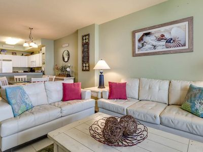Inviting and relaxing coastal decor with an open floor plan in the living area.