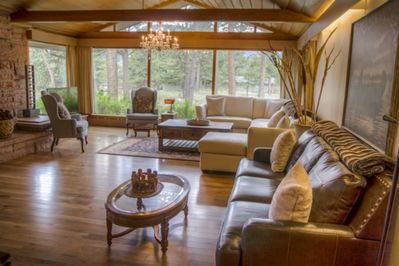 Large living room with gas fireplace and spectacular views of Longs Peak.