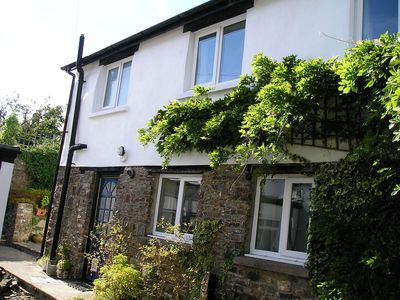 Photo for Courtyard cottage,Dog friendly, 1 lge or 2 small, large garden. Chittlehampton.