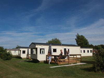 Photo for Comfortable chalet in Wieringer style in a holiday park, directly situated by the Waddenzee.