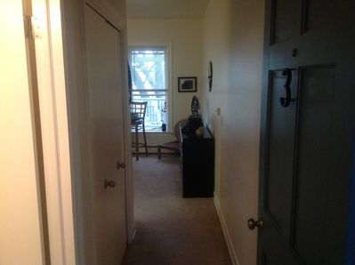 Entrance to your studio apartment with private bathroom & closet on left