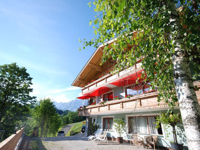 Holiday apartment with partial balcony and view of the mountains