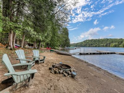 Photo for NEW LISTING! Dog-friendly, lakefront cottage w/ large dock & sandy beach