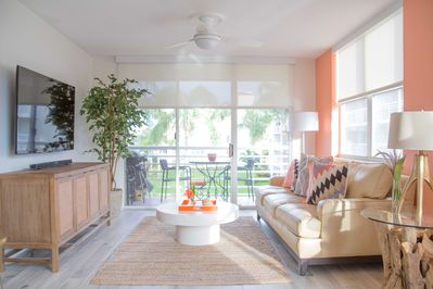 Living room with beautiful view facing the pool and Boca Ciega Bay.