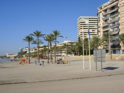 Photo for Apartment 150 meters from the beach. Ideal families, with garden and pool