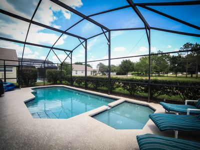 Photo for 4 BR/3 bath house/heated pool/jacuzzi/free wifi/phone/3miles to disney/pets
