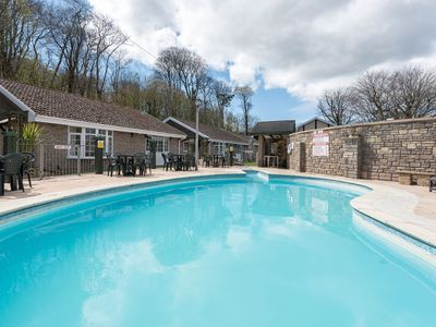 Photo for Pretty bungalow in lovely grounds with use of heated pool.