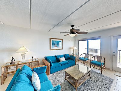 Living Room - Beach-inspired design elements add to the charm of the living room.