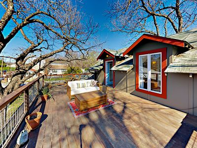 Deck - A 2nd-story deck off of the master bedroom has an outdoor sofa and wooden patio table.