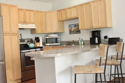 ully equipped kitchen, with microwave, full size fridge, blender & coffee pot