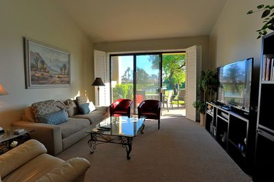 Relax in this lovely living room with beautiful views of the golf course