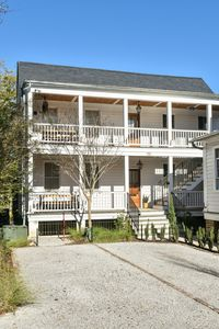 Photo for Historic, Clean + Porch! 5 min Walk to Upper King, 15m Drive to Beach!