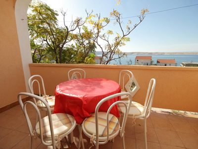 Photo for Two bedroom apartment with terrace and sea view Vidalići, Pag (A-9382-a)