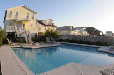 Rear view of house and beautiful pool with shallow area for the little ones.