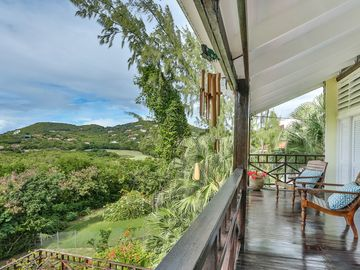 A gorgeous Caribbean style home with views of golf course + Caribbean Sea