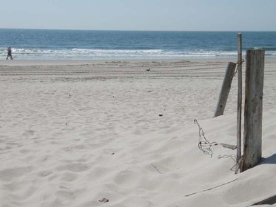 Photo for Beachfront Bargain! Step Off Your Deck Onto a Great Beach!