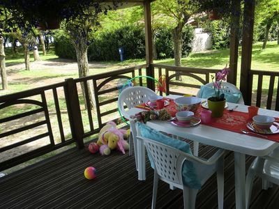 Photo for Small and cosy holiday park on the private beach of beautiful Lake Bracciano.