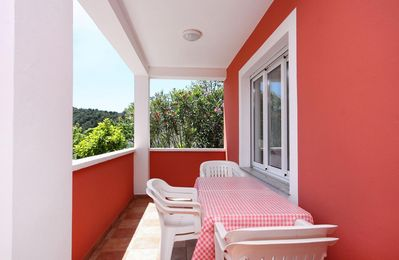 Photo for Two bedroom apartment with terrace and sea view Kampor, Rab (A-4972-a)