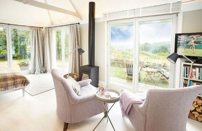 Ground floor:  Sunny, sitting area with wood burning stove