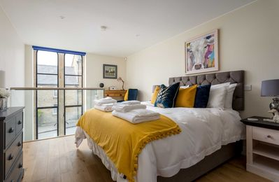 Photo for The Sanctuary is an elegant property laid out over two floors with a wonderful glass balcony.