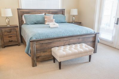 master bedroom 1 with a king-size bed and a walk-in closet